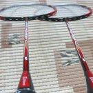 Badminton racket, shuttles and grips.