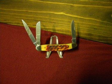 FROST, 3 blade pocket knife w/orange pickbone handles.