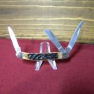 FROST, 3 blade pocket knife w/brown pickbone handles.