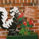 "Handmade wooden custom painted ""Stop to Smell the Roses"" Skunk sign for the yard"
