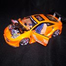 Orange Extreme Tuner  Toyota Celica car with moveable doors and working lights