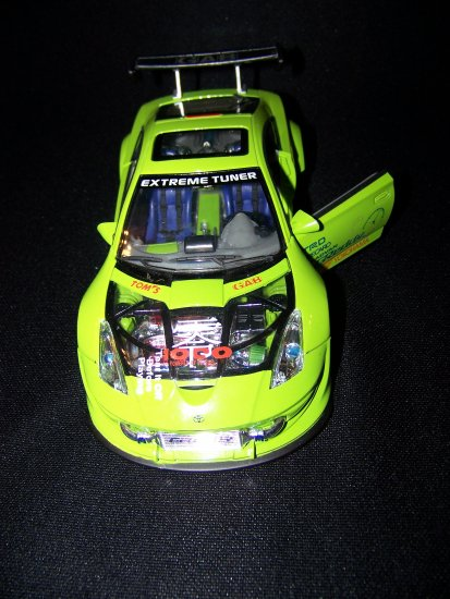 Green Extreme TunerToyota Celica car with moveable doors and working lights