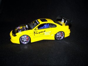 Yellow Extreme Tunner Car with moveable doors and hood, also has working lights