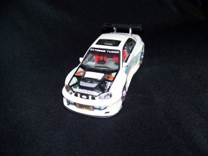 White Extreme Tuner Sti Subara Car with moveable doors and hood, also has working lights