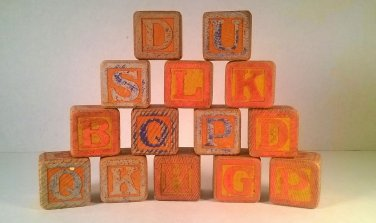 "14 Antique 1 1/4"" Wooden Children's Blocks."