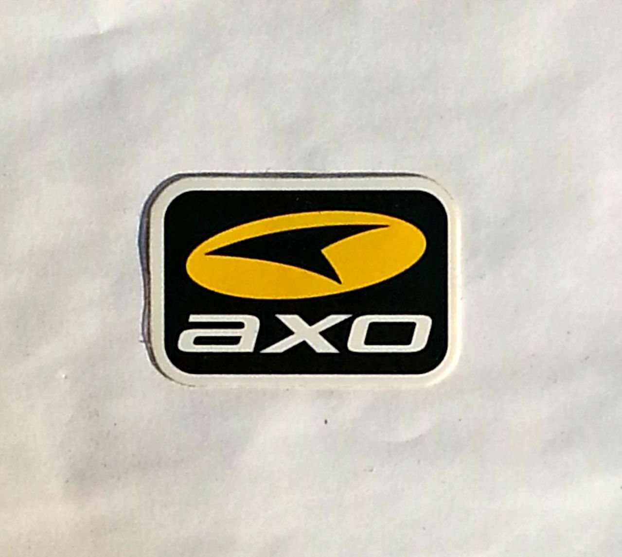"AXO sticker(small) Blk/Yellow - 2 5/8"" x 1 3/4"""