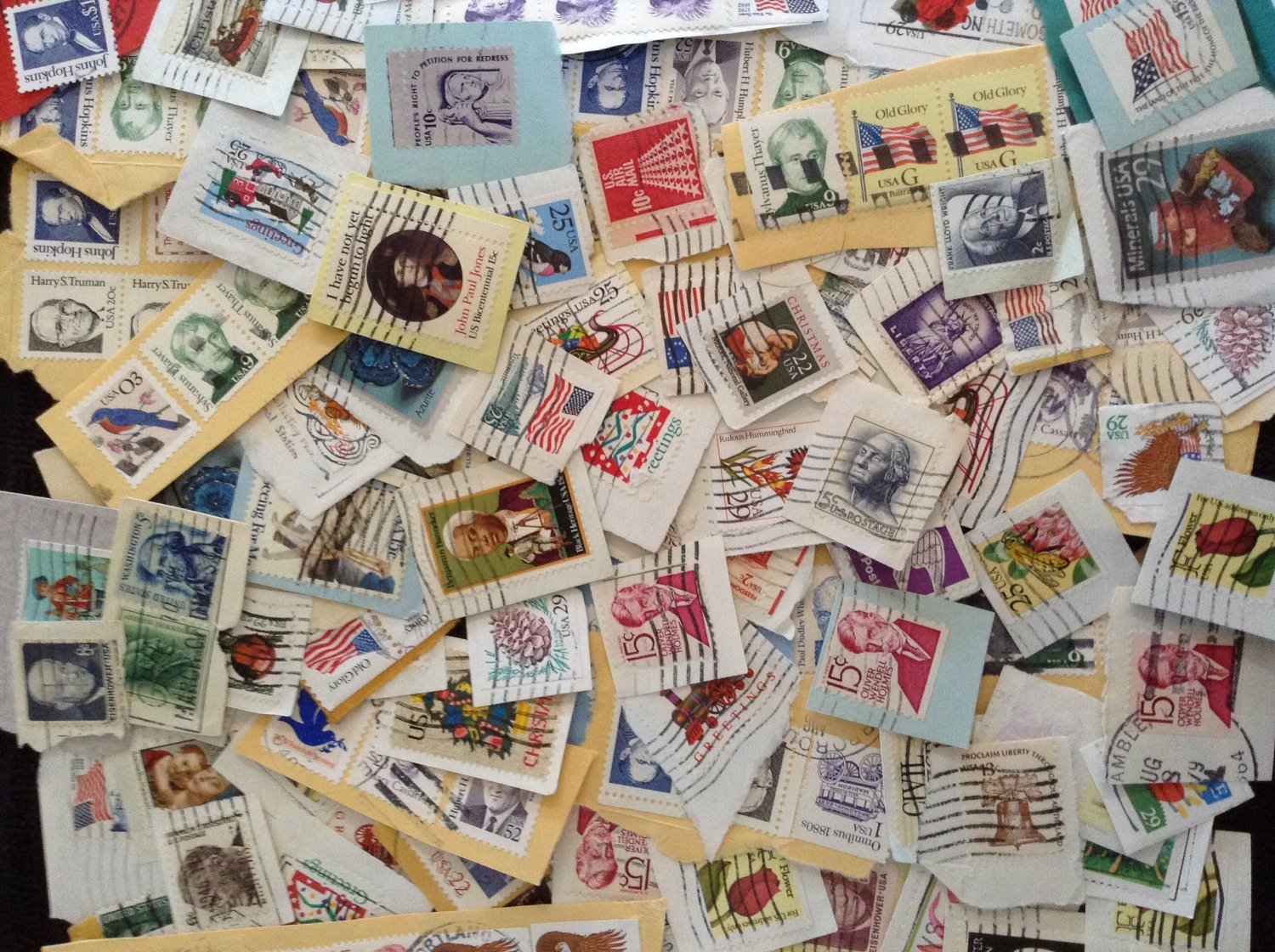 Lot of 25 US Postage Stamps On Paper