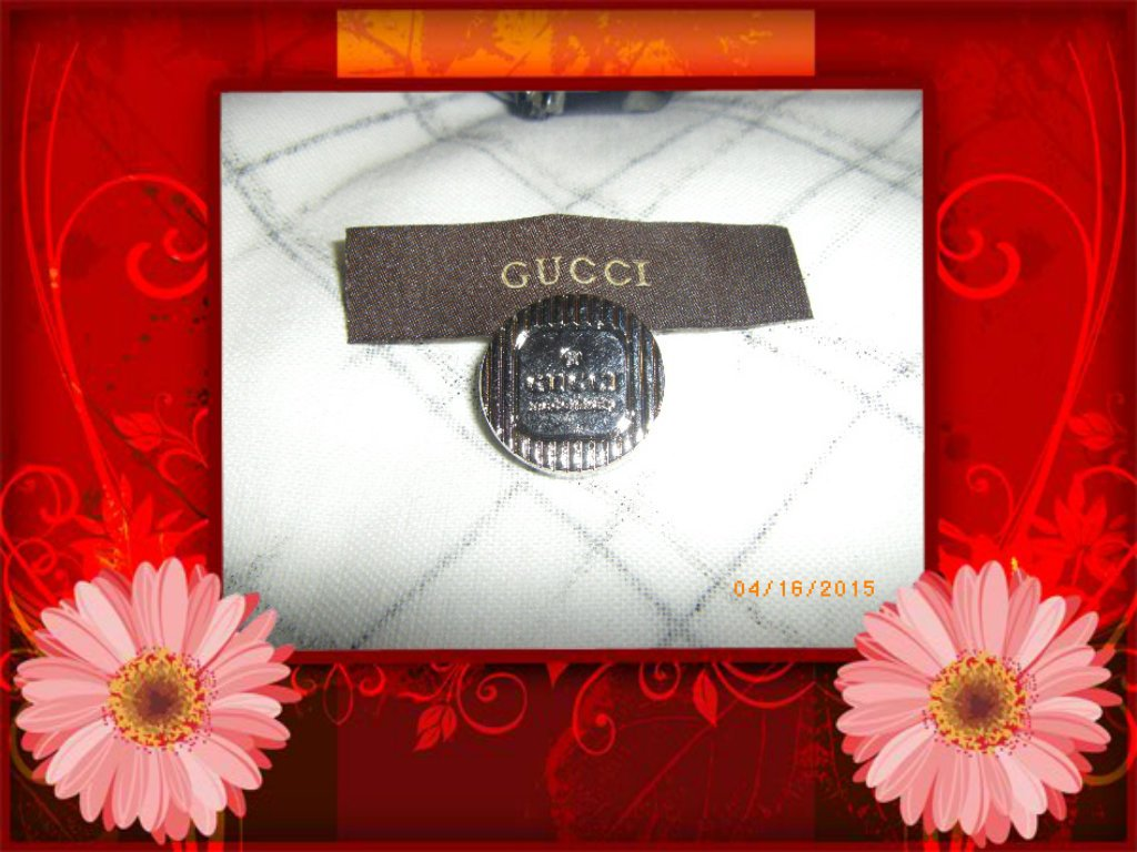 Gold Gucci Button with Clothing Label