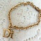 Di International  Charm Goldtone Bracelet