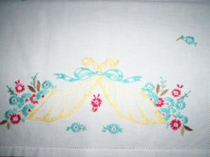 Hand embroidered red and teal flowers in a yellow sconce dresser scarf table runner