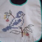 baby bib hand embroidered blue bird cross stitch wild flowers handmade