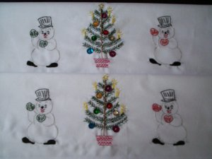 set of 2 hand embroidered Pillowcases all handmade snowmen and Christmas tree