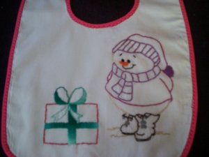 baby bib hand embroidered handmade snowman and present with hot pink binding