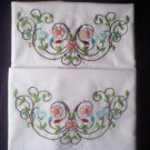 vine of red and blue flowers 2 pillowcases hand embroidered