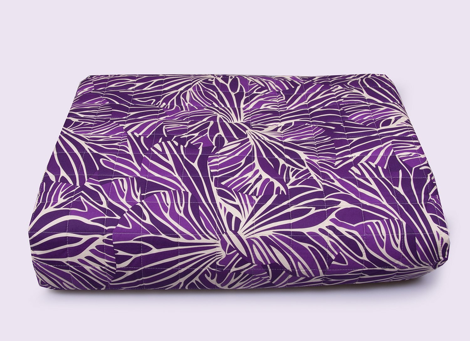 Missoni bedspreads with stylized leaves on purple colors for double bed