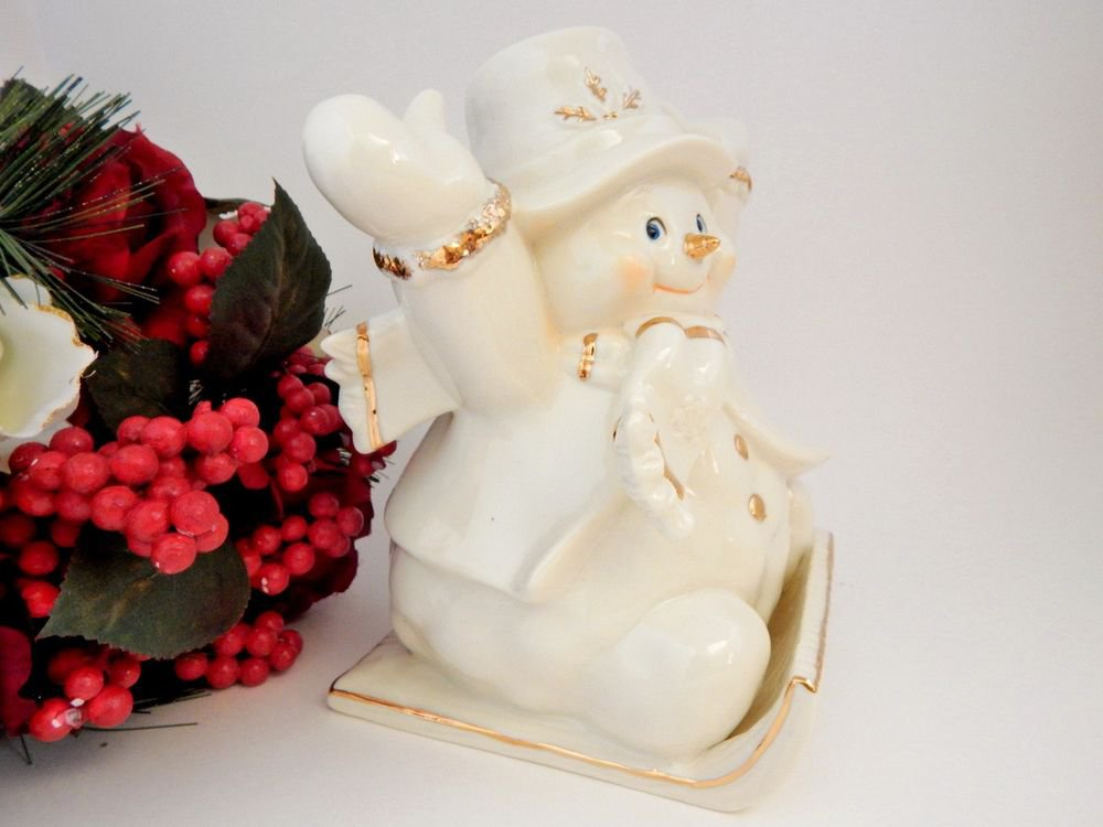 Sledding Snowman Christmas Figurine White and Gold Ceramic Winter Holiday Decor