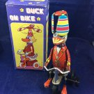 vintage Duck on Bike metal wind-up toy by Blic