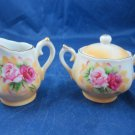 Vintage miniature toy sugar & creamer porcelain set with pink roses marked L-375