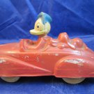 Donald Duck with red Pluto in car by the Sun Rubber Company Disney collectible
