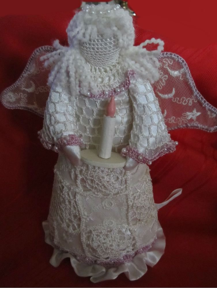 white Cloth Christmas Angel decoration with purple trim and holding a candle