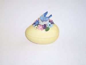 "Decorative Egg with a Bluebird in a nest of colorful Flowers.5""h 43/4""L"