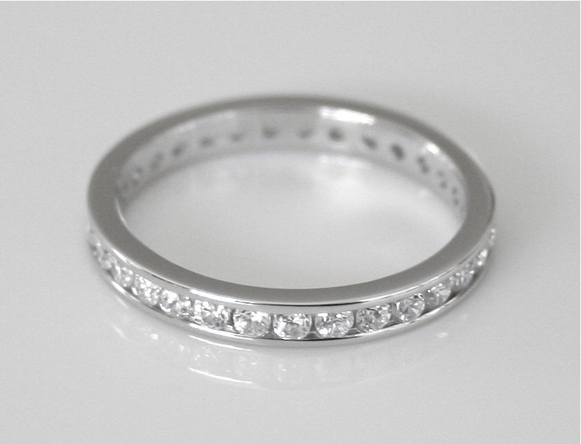 3MM STERLING SILVER CHANNEL SET ROUND CUT CZ ETERNITY RING (SIZES H - V)