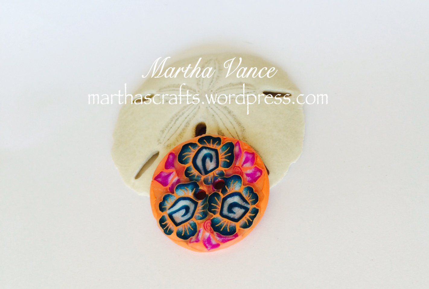 Coral polymer clay button with flowers