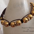 Chocolate wrapped gold peanut with Crystal Macrame Bracelet $49