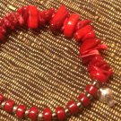 Red Coral Stretchy Bracelet with Sterling Silver Fish Charm $37
