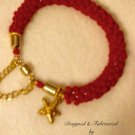 Red And Gold Colored Thread Woven Bracelet Bangle
