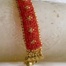 Beautiful Hand Woven Red-Orange w/Gold Clover Pattern Bracelet
