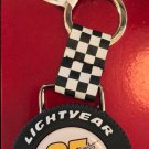 DISNEY PARKS CARS LIGHTNING MCQUEEN LIGHTYEAR RUBBER TIRE KEYCHAIN NEW