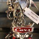 DISNEY PARKS CARS CARS LAND DICE AND HOOD ORNAMENT METAL KEYCHAIN  NEW