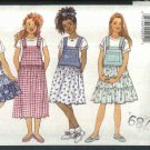 Butterick Sewing Pattern 3869 Girls Size 7-14 Easy Overall Style Jumper Dirndl Tiered Skirt