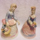 SET OF TWO...PORCELAIN LADIES WITH FLORAL ACCENTS....BELLS RING...SO DETAILED