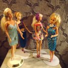 BARBIE DOLLS....SET OF FOUR.....NICE WITH CLOTHING""