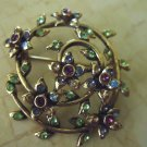 VINTAGE BROOCH-SIGNED MONET-GOLDTONE WITH MULTI COLORED RHINESTONES/FLOWERS