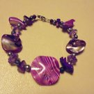 "NICE 7"" TO 7 1/2"" MIXED PURPLE SHELL STYLE BEADED LADIES/GIRLS BRACELET"