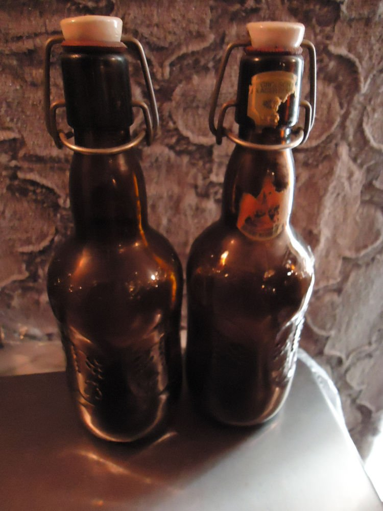 VINTAGE SET OF TWO OLD GROLSCH PORCELIN STOPPER BROWN  BEER BOTTLES