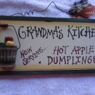 "HANGING PLAQUE.""NANA'S KITCHEN COME GATHER AROUND"" WOOD WITH WIRE HANGAR.."