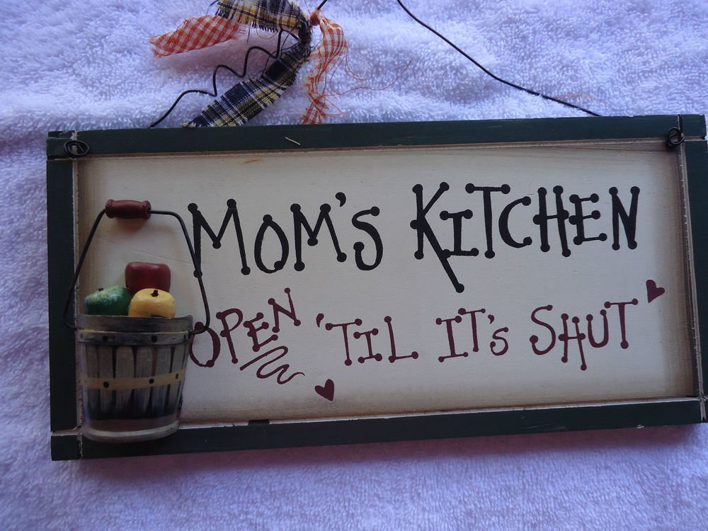 "HANGING PLAQUE.""MOM'S KITCHEN OPEN TILL IT'S SHUT"" WOOD WITH WIRE HANGAR.."