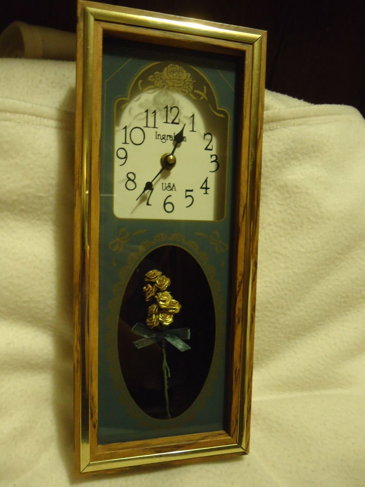 NICE INGRAHAM DESK /MANTLE CLOCK MADE IN THE USA WITH FLOWERS IN BOTTOM PART..
