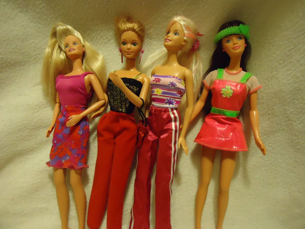 BARBIES...FULLY DRESSED..LOT OF FOUR..JOINTED.....NICE VARIETY