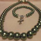 GREEN BEADED NECKLACE, EARRINGS & COMFORT CROSS BRACELET....APPROX 19""