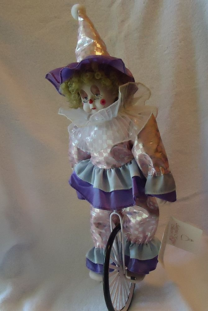 AUTHENIC HERITAGE COLLECTORS PORCELAIN CLOWN RIDING UNICYCLE..APPROX 18""