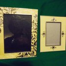 UNIQUE SET OF 2 METAL/ENAMELED PICTURE FRAMES WITH FANCY TRIM..OVERALL SIZE