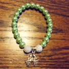 LT GREEN LADIES BEADED WITH DOUBLE PARROT CHARM BRACELET-EXPANDABLE