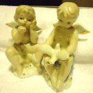 "TWO STUNNING CHERUBS PORCELAIN AND SO UNIQUE....APPROX 6 1/2"" TALL"