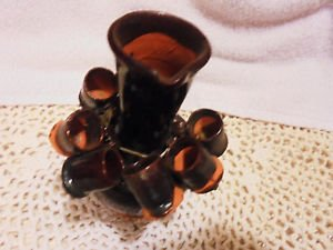 "MINI BROWN STONEWARE POTTERY JUG..4 1/2"" TALL.WITH SIX LITTLE CUPS HANGING ON IT"
