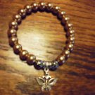 LADIES GOLDEN BROWN BEADED BRACELET WITH BUTTERFLY CHARM -EXPANDABLE